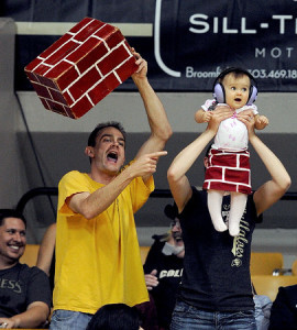 """CU Drexel Men86.JPG Colorado fans, Brian Schlatter, left, his wife, Julia, and daughter, Alexis, 9-months, take the brick theme to the top when trying to harass Drexel shooters during the first half of the November 14, 2014 game in Boulder. Cliff Grassmick / November 14, 2014 """